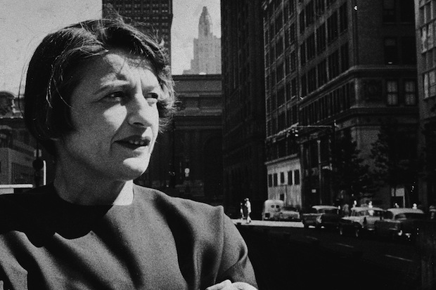 Russian-born author and philosopher Ayn Rand (1905 - 1982) stands with her arms folded on a street in New York City, 1957. (Photo by New York Times Co./Getty Images)
